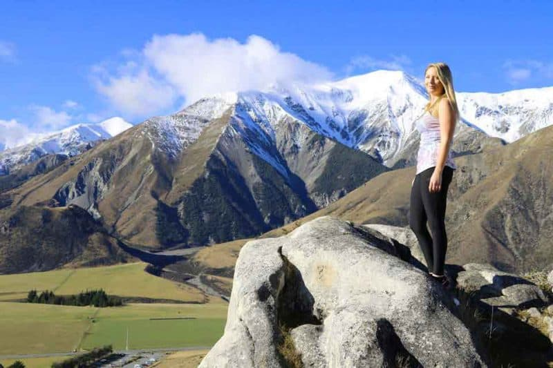Yvette Morrissey stands atop a rock in Castle Hill, Canterbury New Zealand