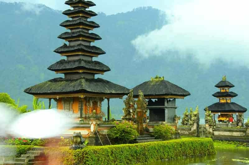 A temple in Bali surrounded by trees and mountains