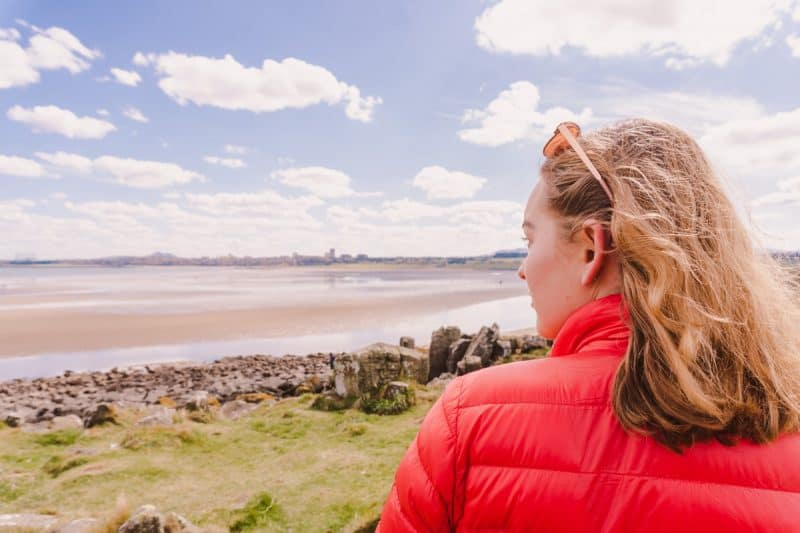 Woman looking out to the sea from Cramond Island