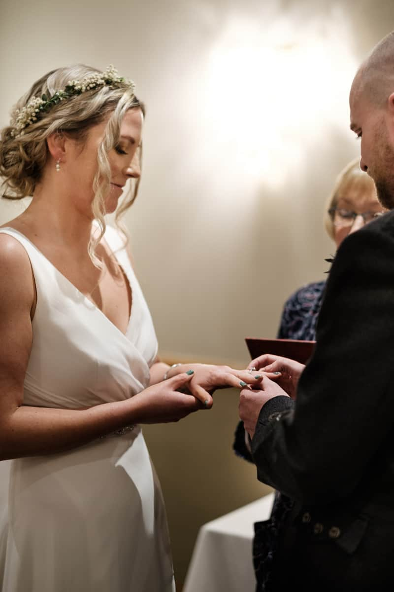 Craig placing the wedding ring on my finger