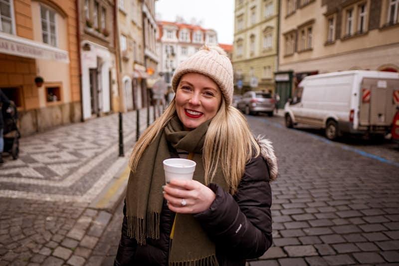 trying hot wine from a street vendor in prague czech republic