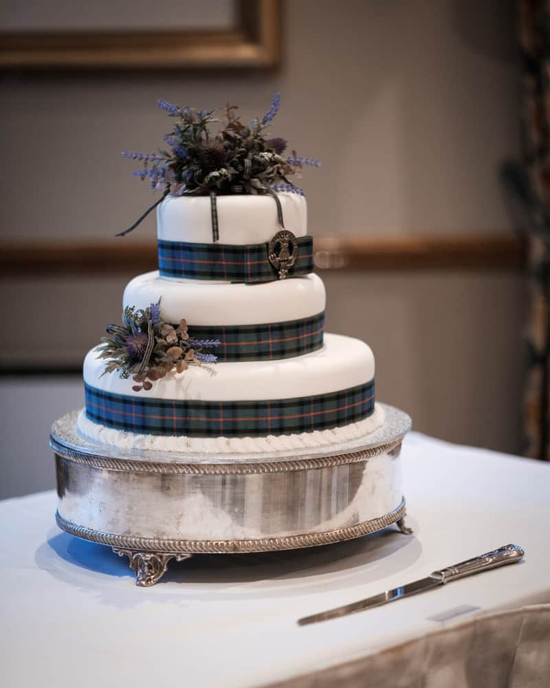 Our Scottish wedding cake with a Scottish thistle and Kiwi silver fern