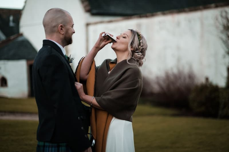 Yvette taking a shot from Craig's hipflask wedding photography