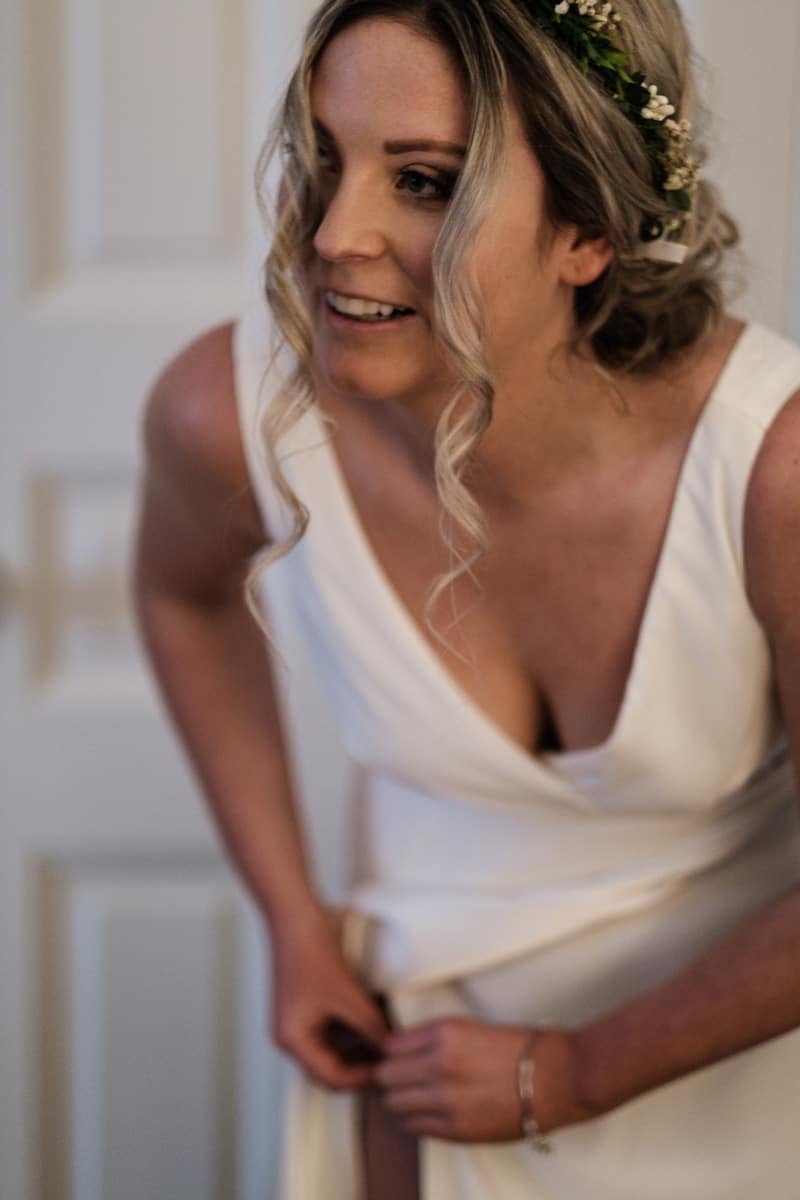 Yvette in mirror getting ready for wedding