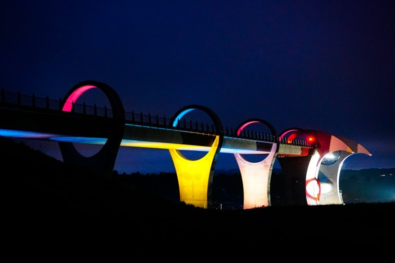 the falkirk wheel lit up at night in scotland